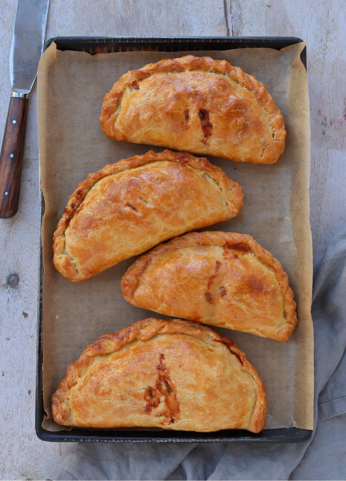 Cheese, Marmite & Potato Pasties on a baking tray